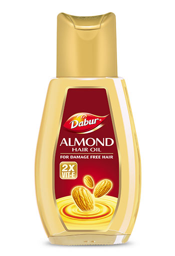 Oil Your Hair with Dabur Almond Hair Oil to Prevent Oily Scalp